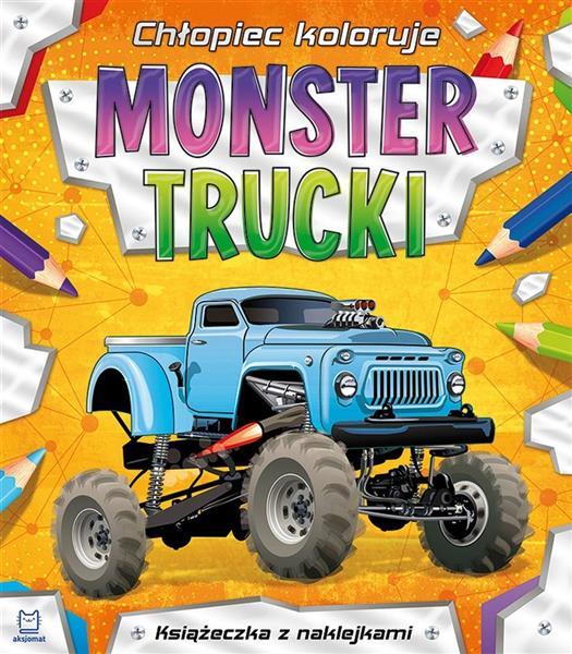 Chłopiec koloruje. Monster trucki