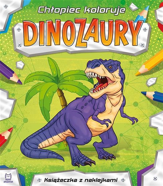 Chłopiec koloruje. Dinozaury